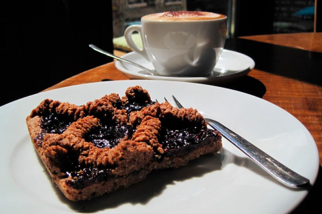 Cake and oatmilk cappuccino
